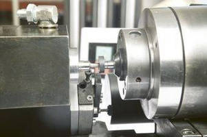 CNC Grinding Machine adds functionality with rotary fixture.