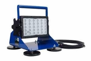 Portable LED Work Light has magnetic pedestal mount.