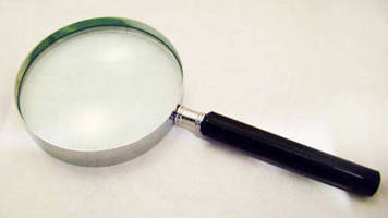 Glass Lens Hand Magnifier aids inspection and reading.