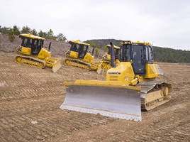 Crawler Dozers feature automatic blade control.