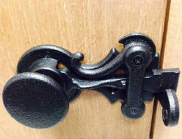 Colonial Knob Latch features cast iron design.