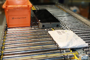 Transfer Conveyor features motor-driven rollers.