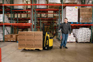 Walkie Pallet Truck enables simultaneous lift and travel.