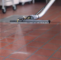 High-Powered Spray Nozzle cleans grout.