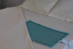 Incontinence Sensor alerts caregivers of in-bed moisture.