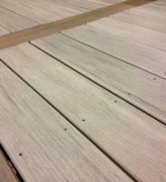 Composite Decking mimics look of hand-hewn lumber.