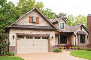 Steel Garage Door offers old world style with modern materials.
