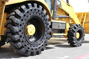 Solid Cushion Tires increase backhoe traction and stability.