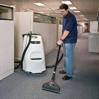Portable Carpet Extractor features upright design.