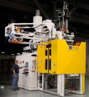 Accumulator-Head Blow Molder produces small industrial parts.