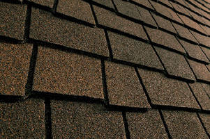 Asphalt Shingles feature triple-layer construction.