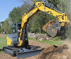 Zero-Tail-Swing Compact Excavator offers 9,419 lb bucket breakout.