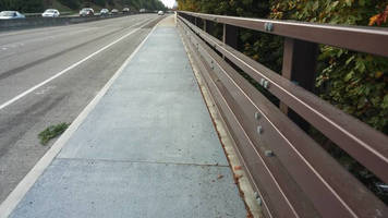 Cantilever Sidewalk lets pedestrians safely share bridge roads.