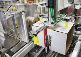 Automated Case Packing Machine meets tissue industry needs.