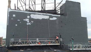 Spider Provides Access for Painting of St. Louis Mural