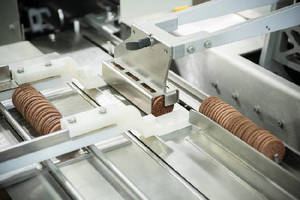 Packaging System handles biscuits and crackers in slug packs.