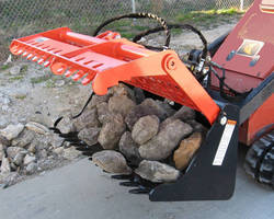 Skid Steer/Tool Carrier Attachment sorts rocks and debris.