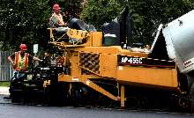 Asphalt Paver offers doors to access all service areas.