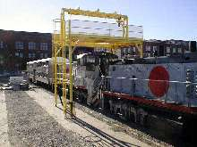 Gantry provides access to railcar air conditioning units.