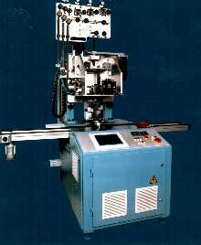 Needle Winder features programmable servo axes.