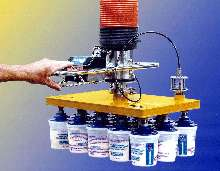 Vacuum Tube Lifter picks up layers of products.