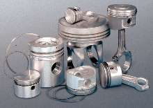 Piston Ring Assembly System suits large diesel pistons.