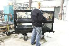 Multi-Shelf Cart brings small parts to assembly line.