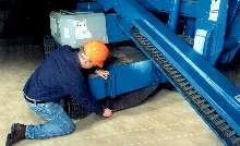 Absorbent Mat hangs under industrial vehicles.