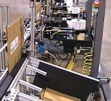 Carton Labeler labels boxes prior to erection/assembly.