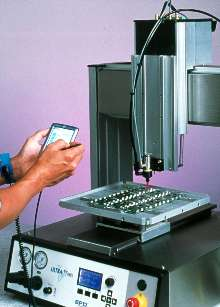 XYZ Dispensing System is programmed with Palm(TM) handheld.