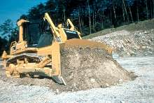 Crawler Dozers feature hydrostatic steering system.