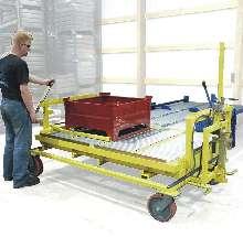 Carts extend reach of conveyor systems.