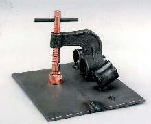 Clamp aligns material for welding applications.