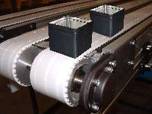 Conveyors help secure and separate items for assembly.