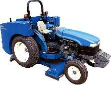 Tractor Scrubber cleans large outdoor facilities.