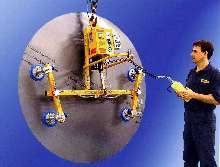 Vacuum Lifter/Tilter has adjustable cups and cross arms.