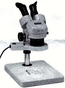 Stereomicroscope employs fluorescent ring illumination.
