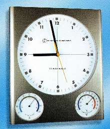 Clock provides time, temperature, and humidity.
