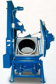 Abrasive Blast Cleaner processes small parts.