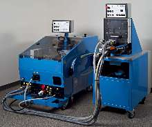 Machine drives fasteners into steel and aluminum sheets.