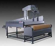 Conveyor Oven dries products up to 65 in. wide.