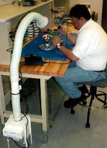 Air Cleaner protects operators during soldering operations.