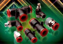 Fittings connect tubes to pneumatic components.