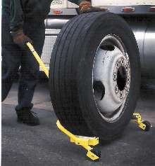 Wheel Dolly moves and aligns mounted tires.