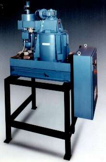 Centrifuge removes grinding solids from coolant and oil.