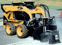 Skid Steer Loader has hydraulic system and vertical lift.
