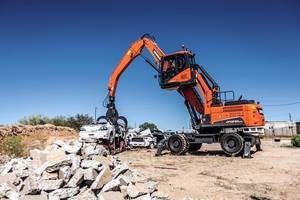 DX210WMH-5 Wheel Material Handler features abrasion-resistant steel grapple.