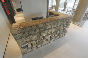 International Steel Service Center 'Direct Metals' Supplies Brass Wire Mesh for Stunning Gabion Reception Desk