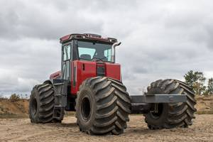 Articulating Multi-Purpose Truck features all-weather ROPS cab.