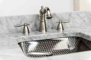 Cubix Undermount Sinks feature diamond pattern and cubical design.